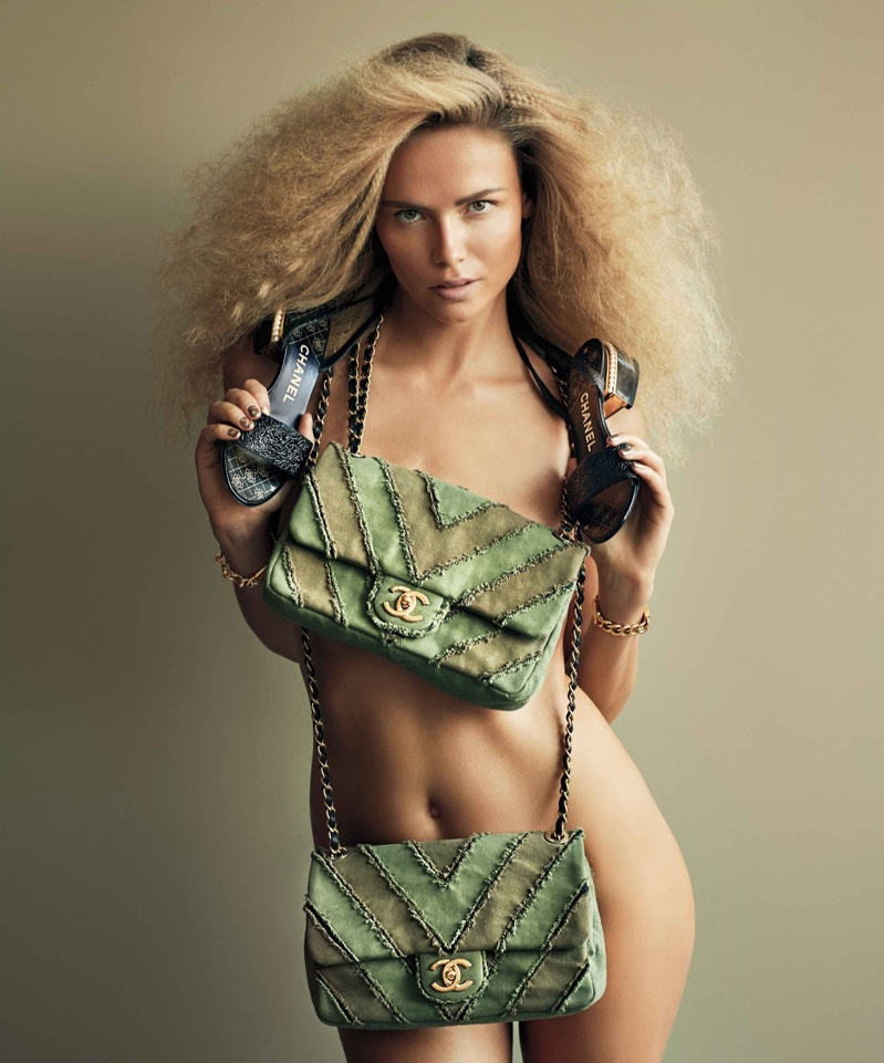 Stripping down, Natasha Poly covers up in Chanel bag and heels