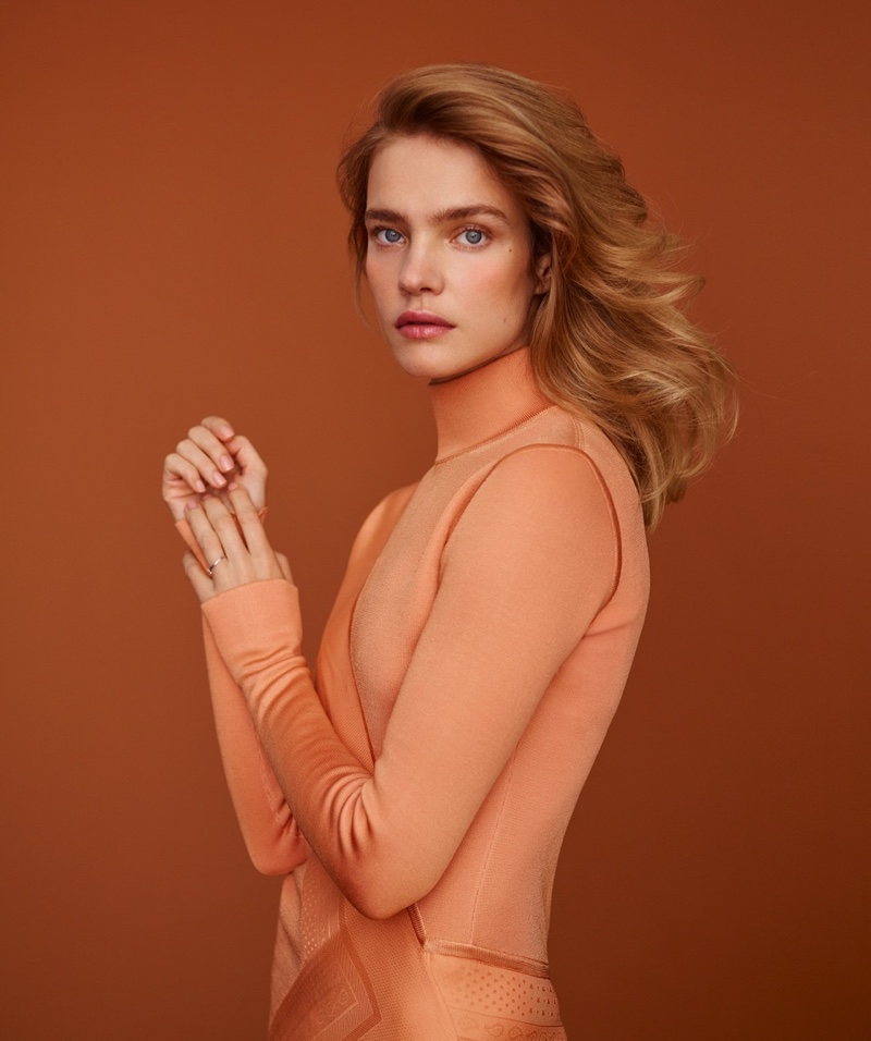 Model Natalia Vodianova wears her hair in polished waves