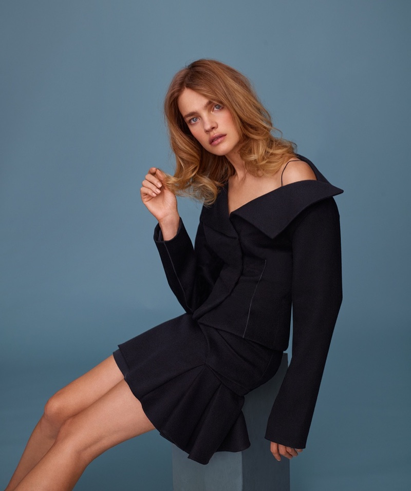 Model Natalia Vodianova poses in Dior off-the-jacket and dress