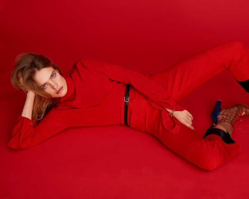 Wearing all red, Natalia Vodianova poses in red top and pants from Nina Ricci