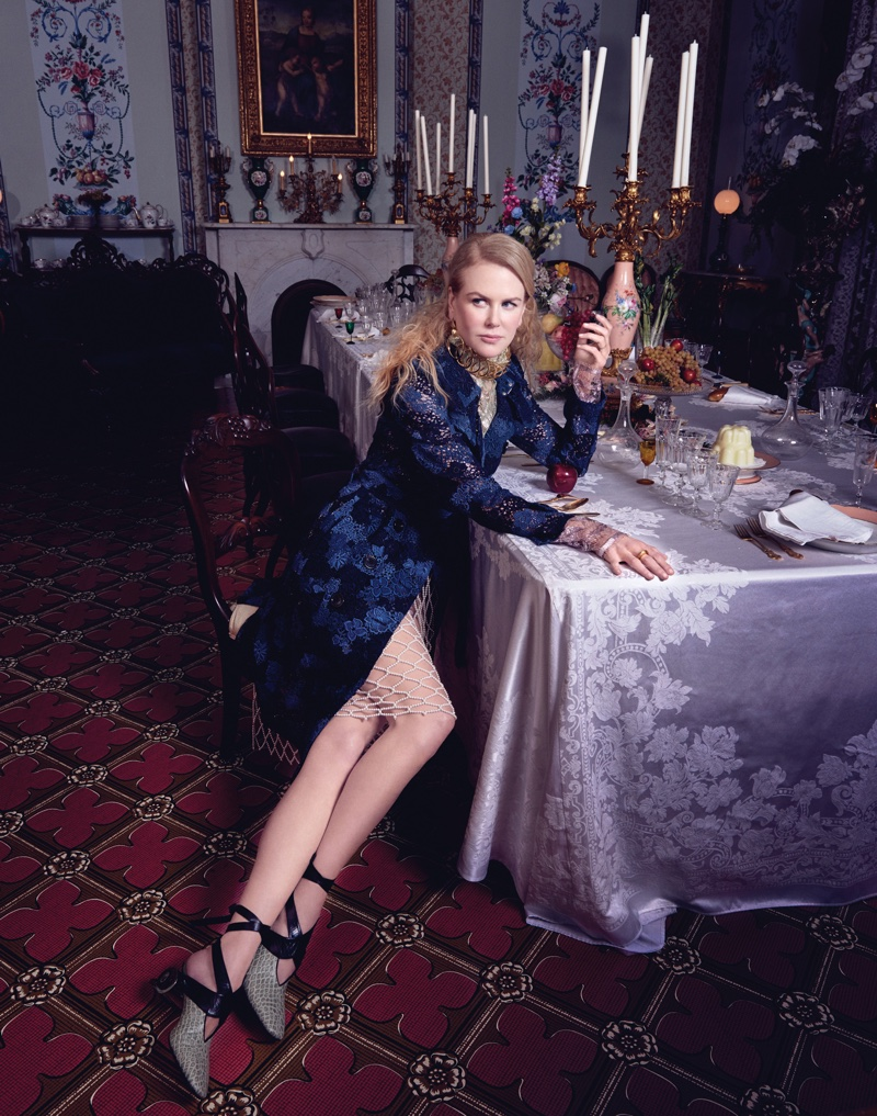 Sitting at a well-set table, Nicole Kidman wears Burberry coat, Lanvin top, Dries van Noten skirt and J.W. Anderson shoes