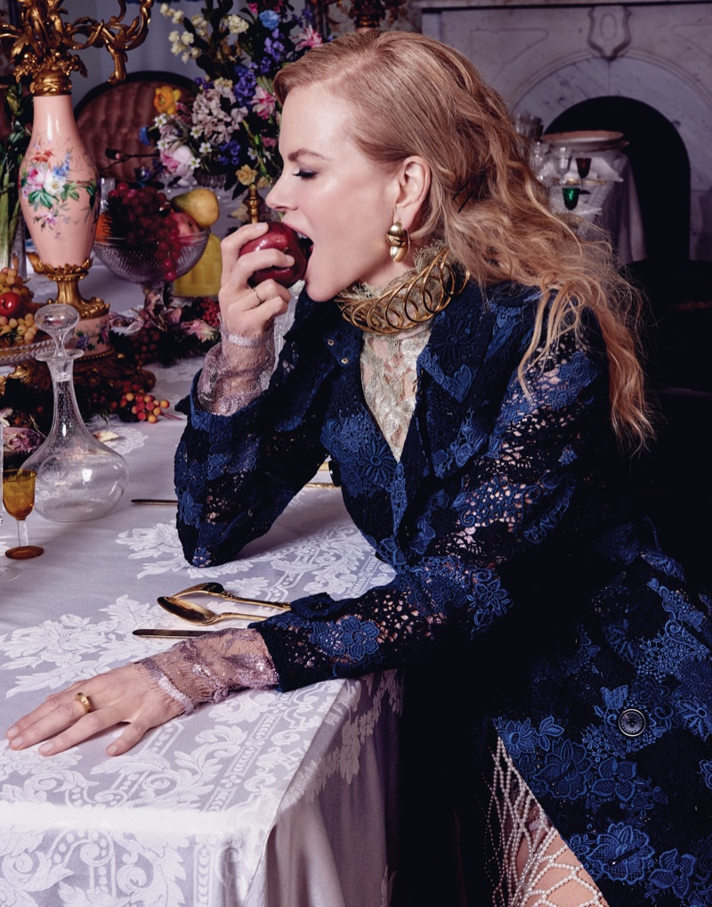 Taking a bite out of an apple, Nicole Kidman wears Burberry coat, Lanvin top and Dries van Noten skirt