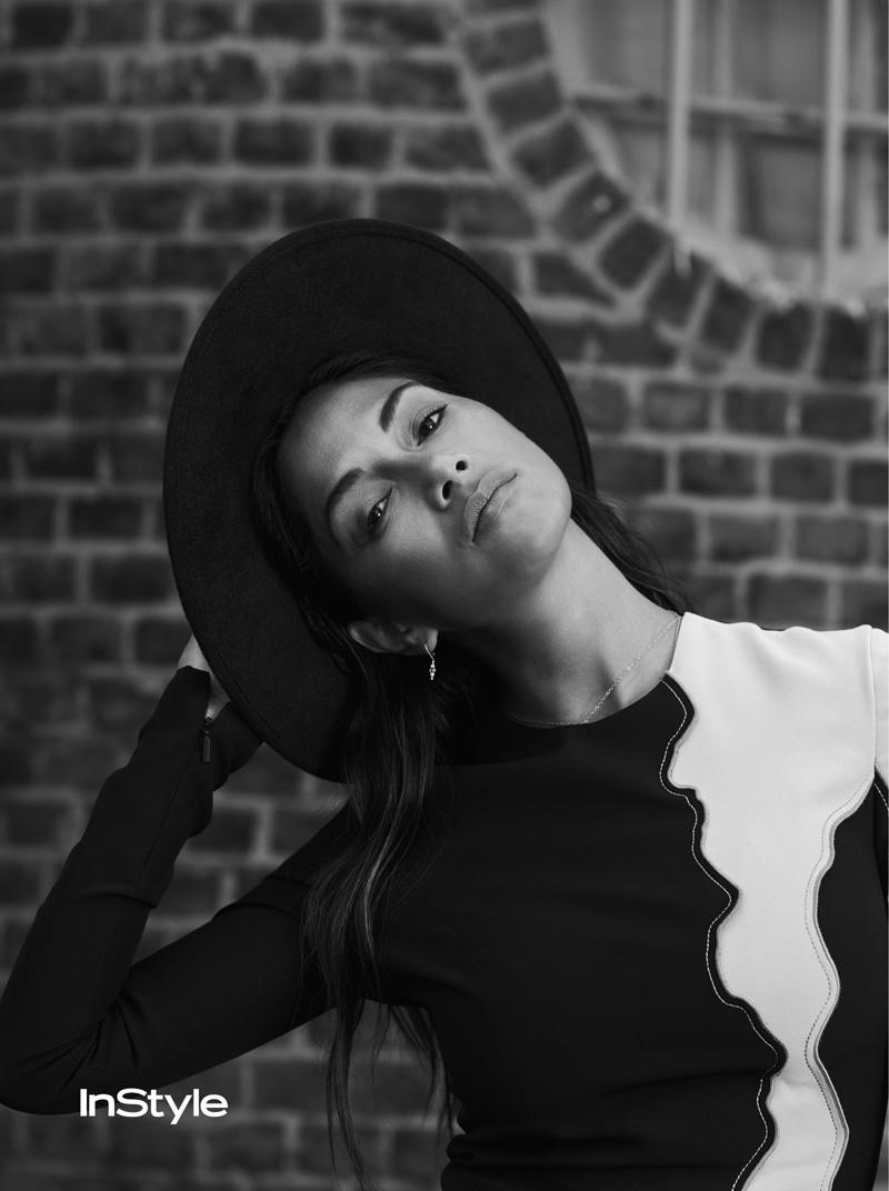 Sporting a wide-brimmed hat, Nicole Scherzinger poses in Versace dress