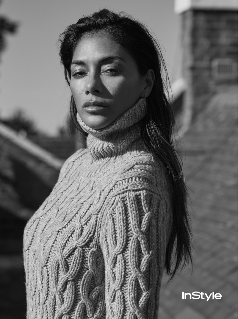 Wearing a cable-knit sweater, Nicole Scherzinger gets photographed in black and white