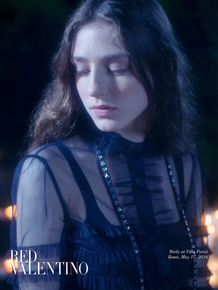 Birdy wears an embellished black dress in red Valentino's fall 2016 campaign