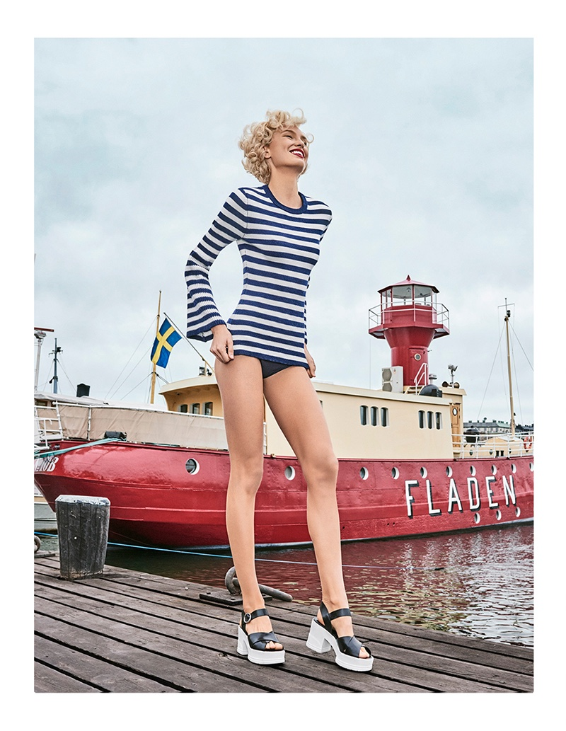 Flaunting some leg, Romee Strijd poses in Michael Kors Collection striped long-sleeve top, briefs and platform sandals
