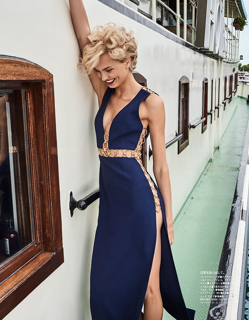 All smiles, Romee Strijd poses in Michael Kors Collection dress with gold detail