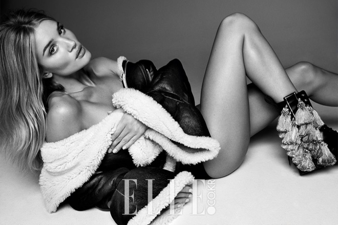 Flaunting her legs, Rosie Huntington-Whiteley wears shearling coat from Burberry