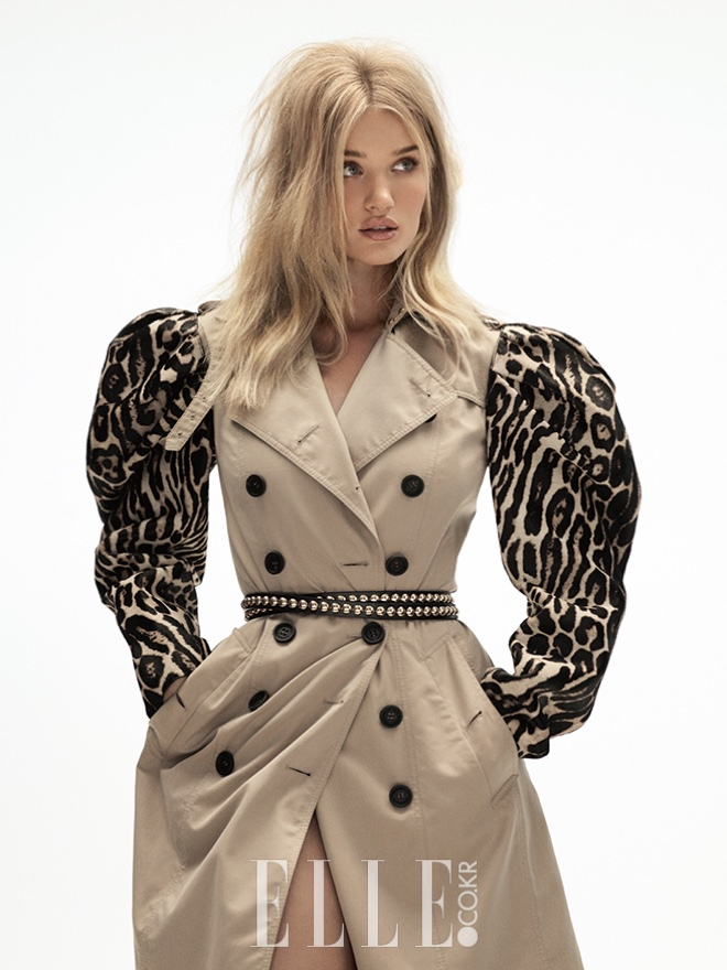 Wearing a brown trench with animal print sleeves, Rosie Huntington-Whiteley serves pure glamour
