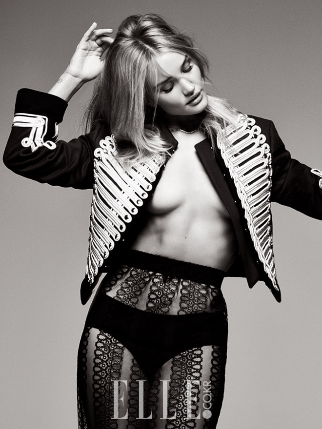 Model Rosie Huntington-Whiteley goes topless in Burberry jacket