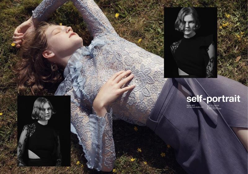 Model wears Self-Portrait cutout floral top and crepe wrap skirt