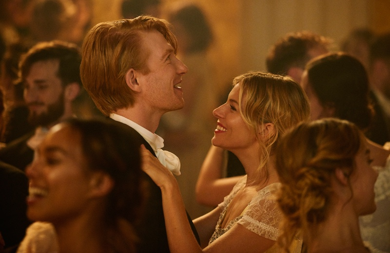 Domhnall Gleeson and Sienna Miller are all smiles in Burberry's holiday film
