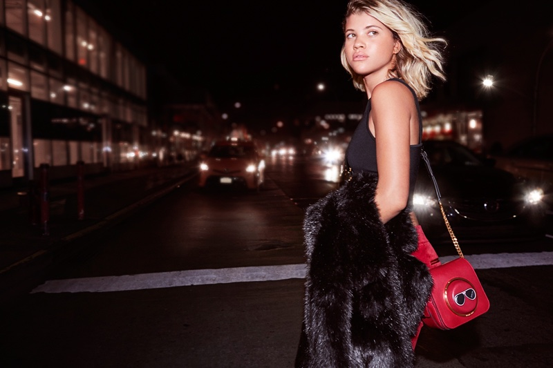 Sofia Richie poses with Michael Kors' Sloan Tango & the Scout camera bag