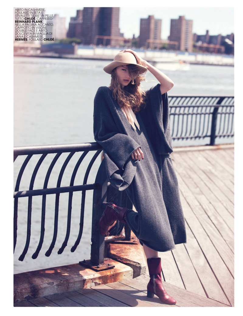 Susanne Knipper poses in Chloe cashmere dress and leather boots with Reinhard Plank hat