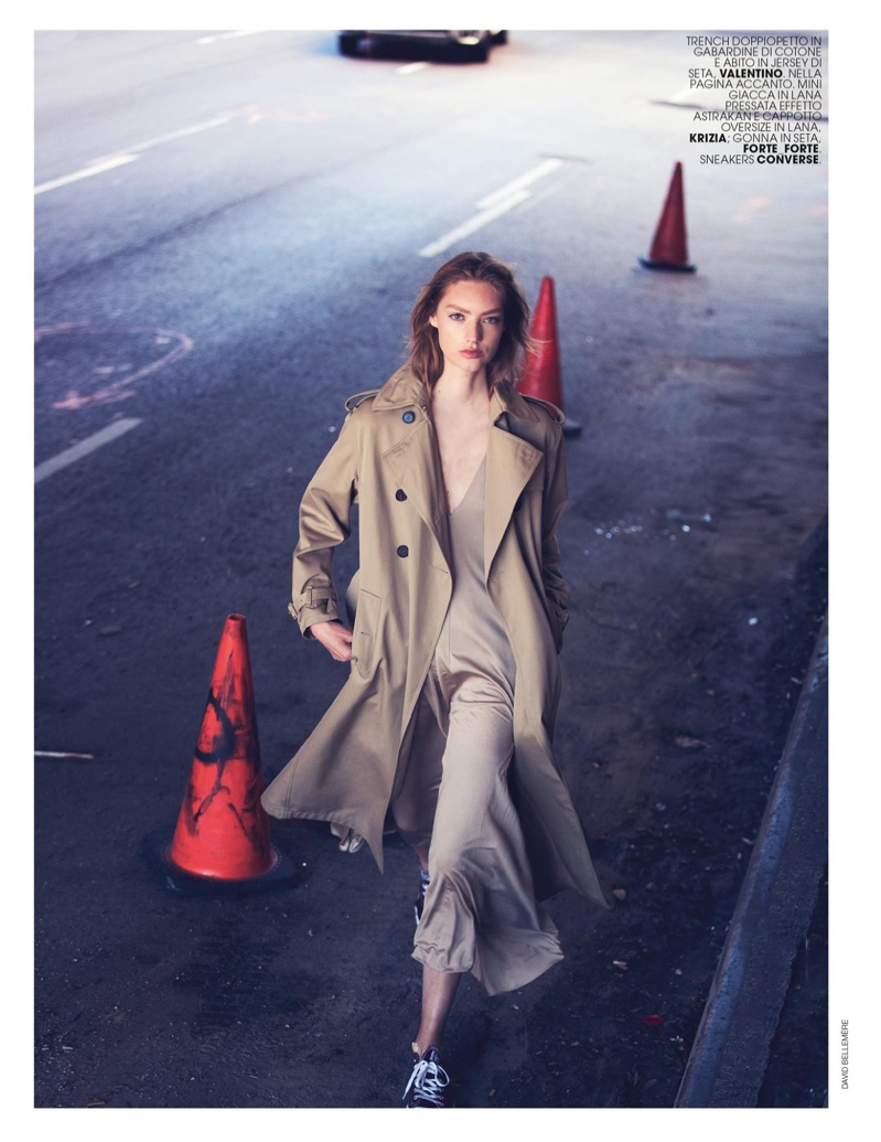 The model hits the streets in trench coat and cotton dress from Valentino