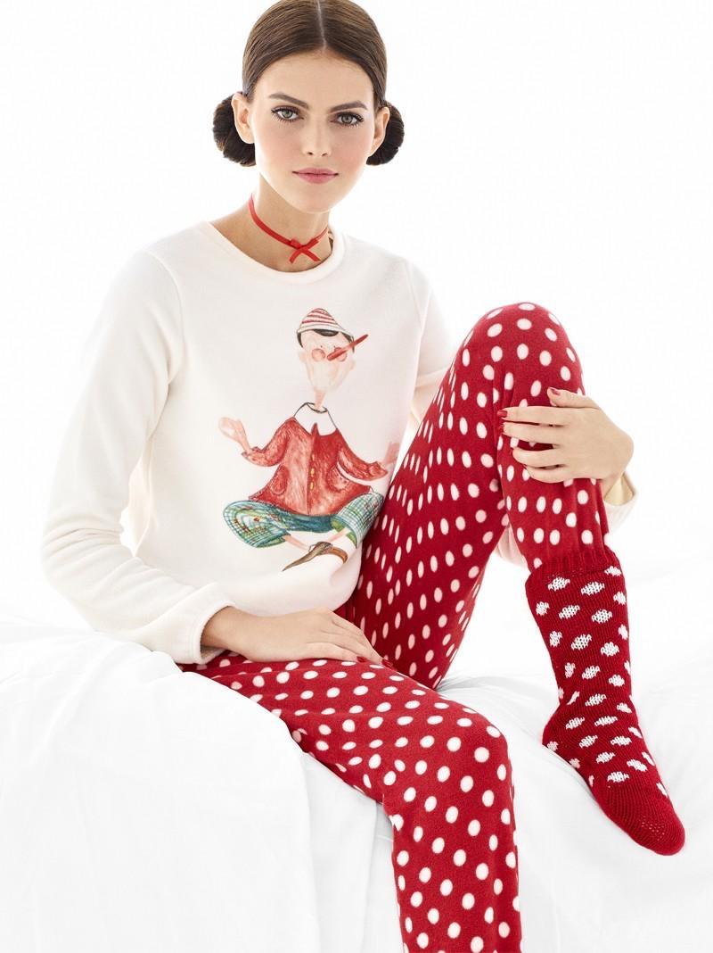 Looking festive, Kamila Hansen wears elf sweater with polka dot print pants and socks