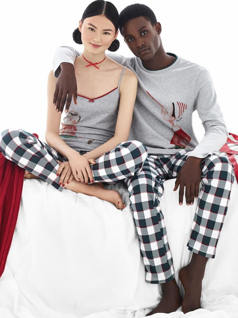 Models He Cong and Victor Ndigwe are mad for plaid in Undercolors of Benetton's holiday catalog