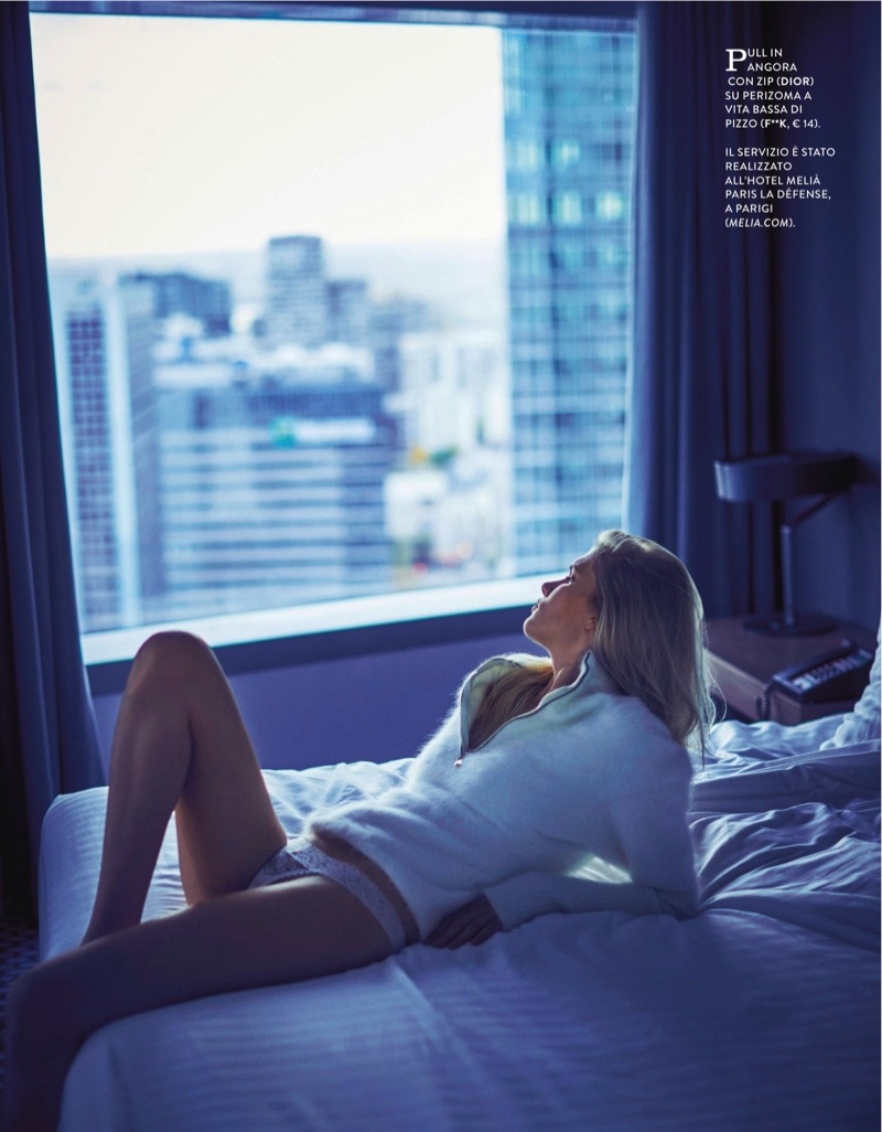 Lounging on a bed, Yulia Terentieva wears angora pullover sweater from Dior