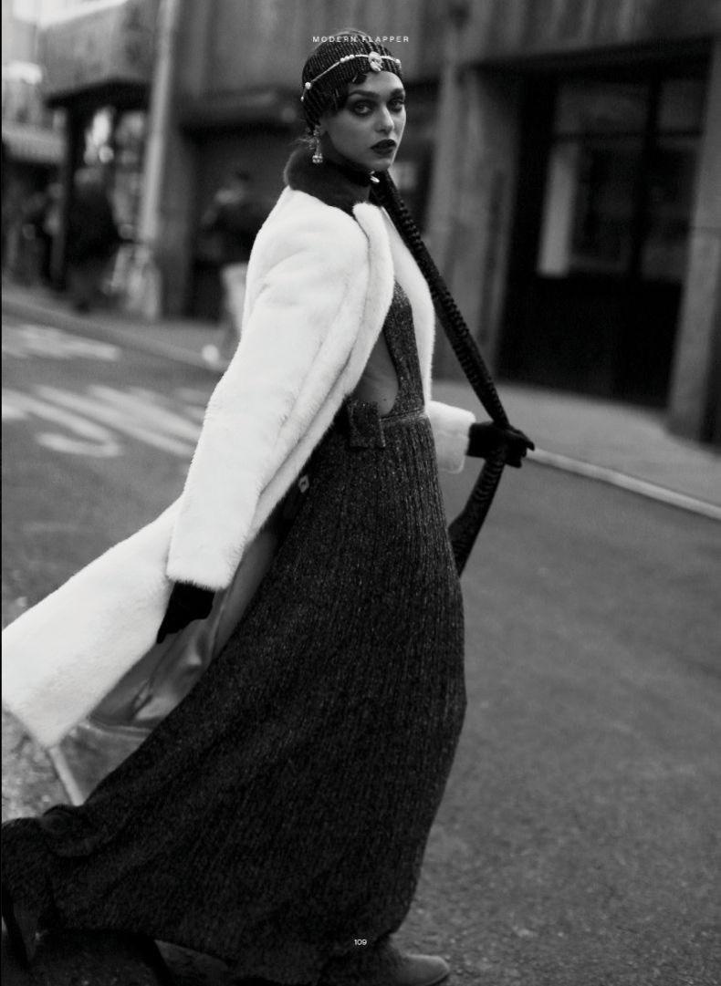 Posing on the streets, Zhenya Katava wears Versace coat and Missoni dress