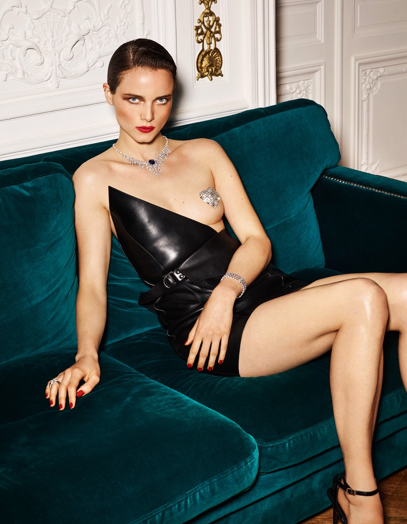 Anna de Rijk poses in asymmetrical leather Saint Laurent dress