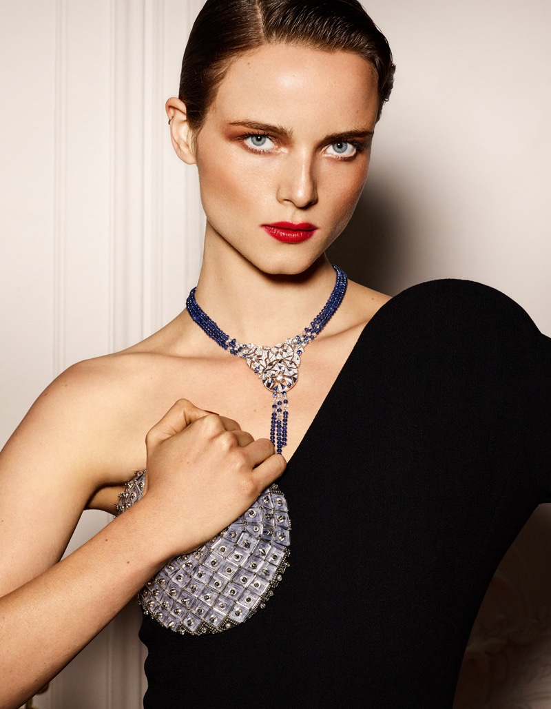 Anna de Rijk models red lipstick with embellished top