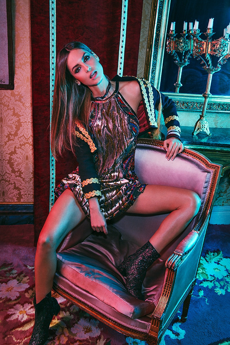 Striking a pose, Ariadne Artiles wears embroidered jacket with metallic minidress and embellished boots