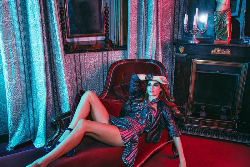 Model Ariadne Artiles lounges in a metallic ensemble