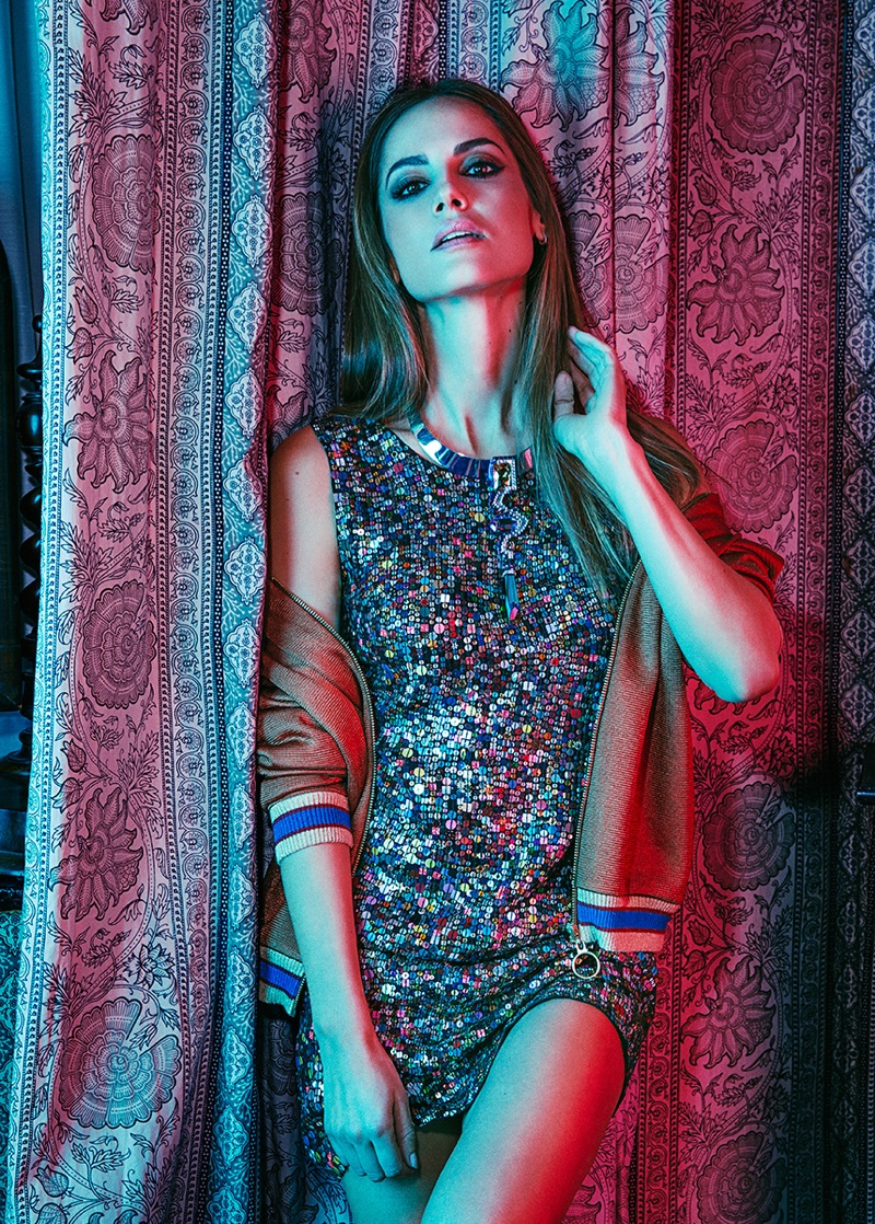 Mixing a sporty jacket with a sequin dress makes for a winning combination