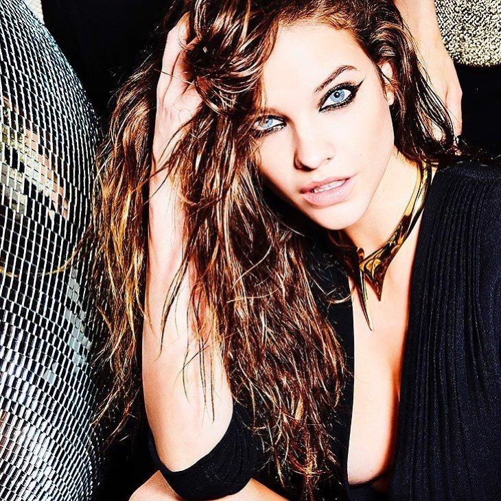 Barbara Palvin poses in a graphic eyeliner look