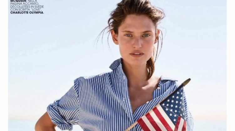 Waving an American flag, Bianca Balti models Twinset shirt, Saint Laurent jeans and Alexander McQueen belt