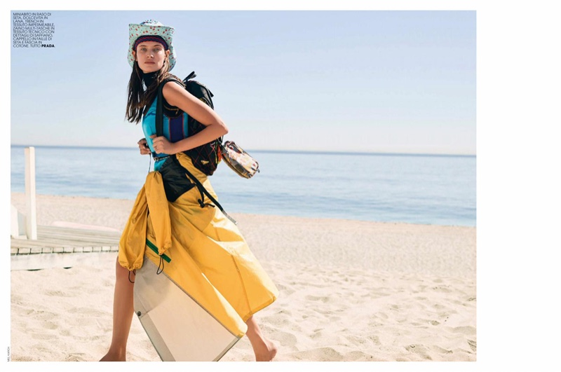 On the beach, Bianca Balti layers up in Prada outfit