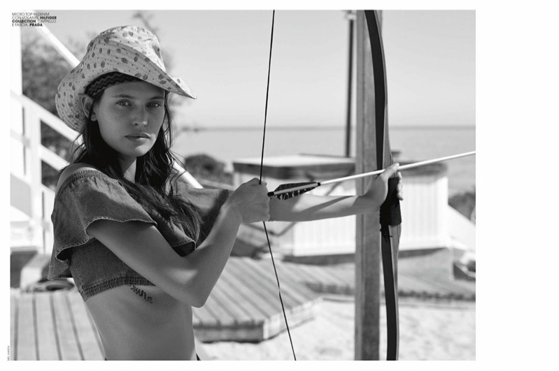 Photographed in black and white, Bianca Balti wears Hilfiger Collection cropped top and Prada hat
