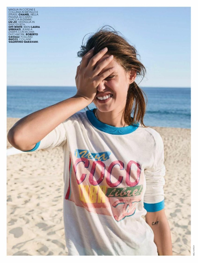 Bianca Balti flashes a smile in Chanel t-shirt