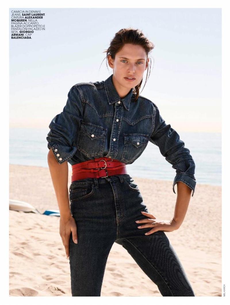Bianca Balti models Saint Laurent denim shirt and jeans with Alexander McQueen belt