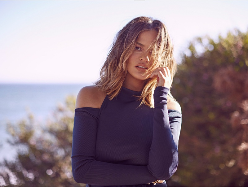 Showing some shoulder, Chrissy Teigen wears Christopher Esber top