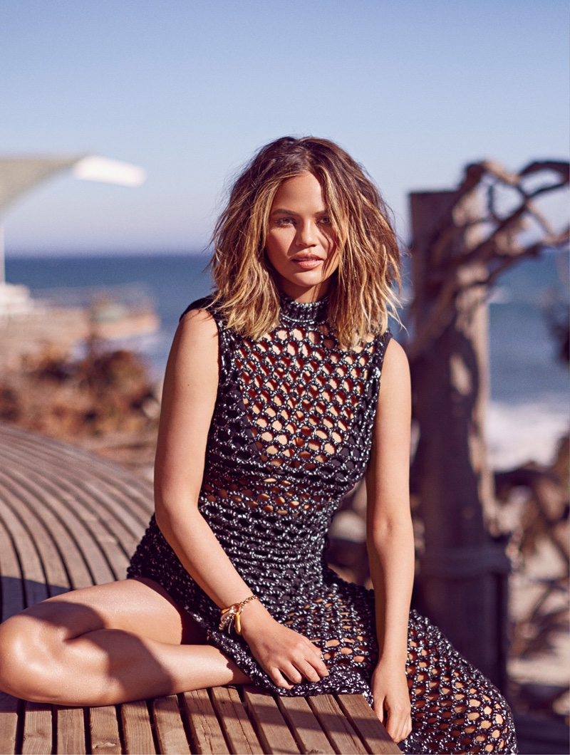 Chrissy Teigen poses in Sportmax net dress with Fella bikini underneath