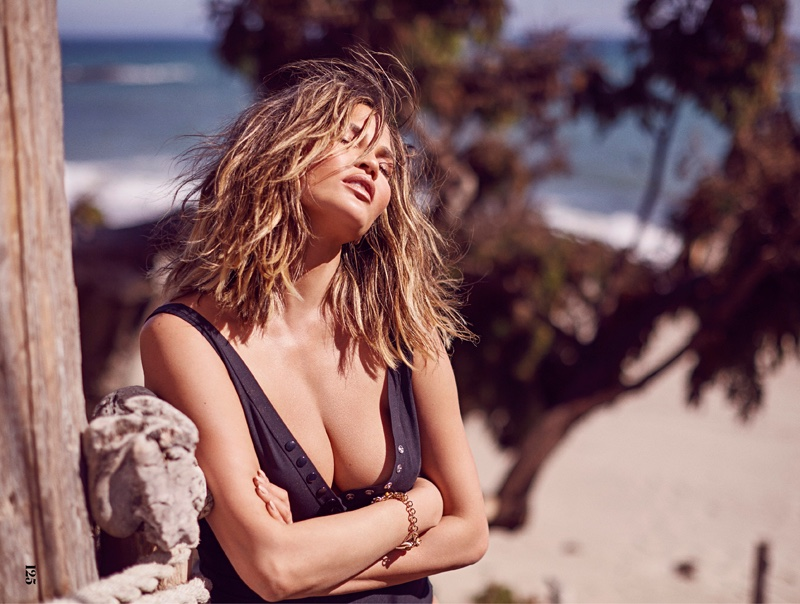 Soaking up the sun, Chrissy Teigen models Eres swimsuit