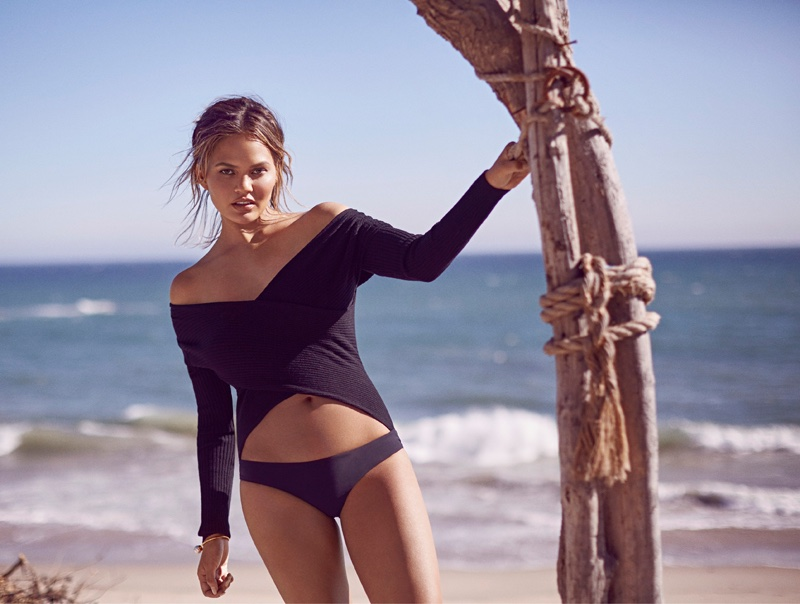 Chrissy Teigen wears Witchery top and Matteau bikini briefs with Sarina Suriano bangle