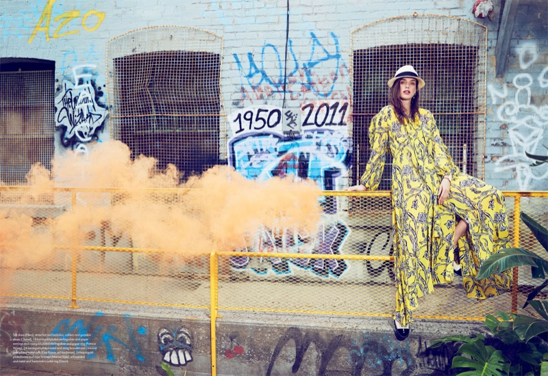 Embracing print, Crista Cober models Ellery dress with Chanel hat and shoes