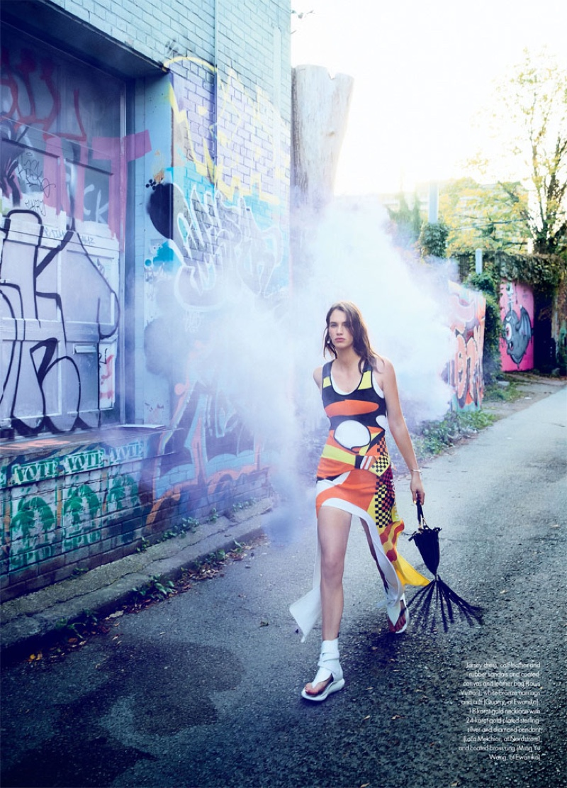 Hitting the streets, Crista Cober models Louis Vuitton dress, sandals and bag