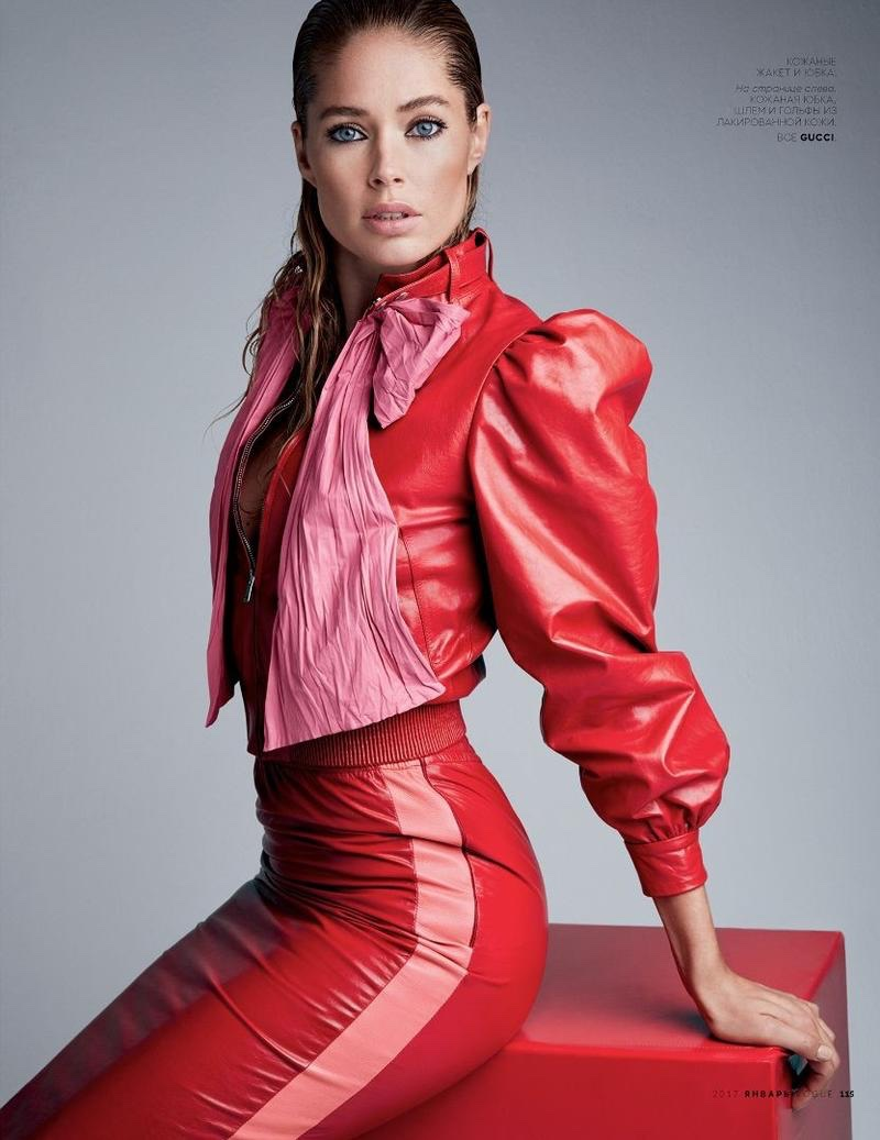 Model Doutzen Kroes poses in leather jacket and skirt from Gucci