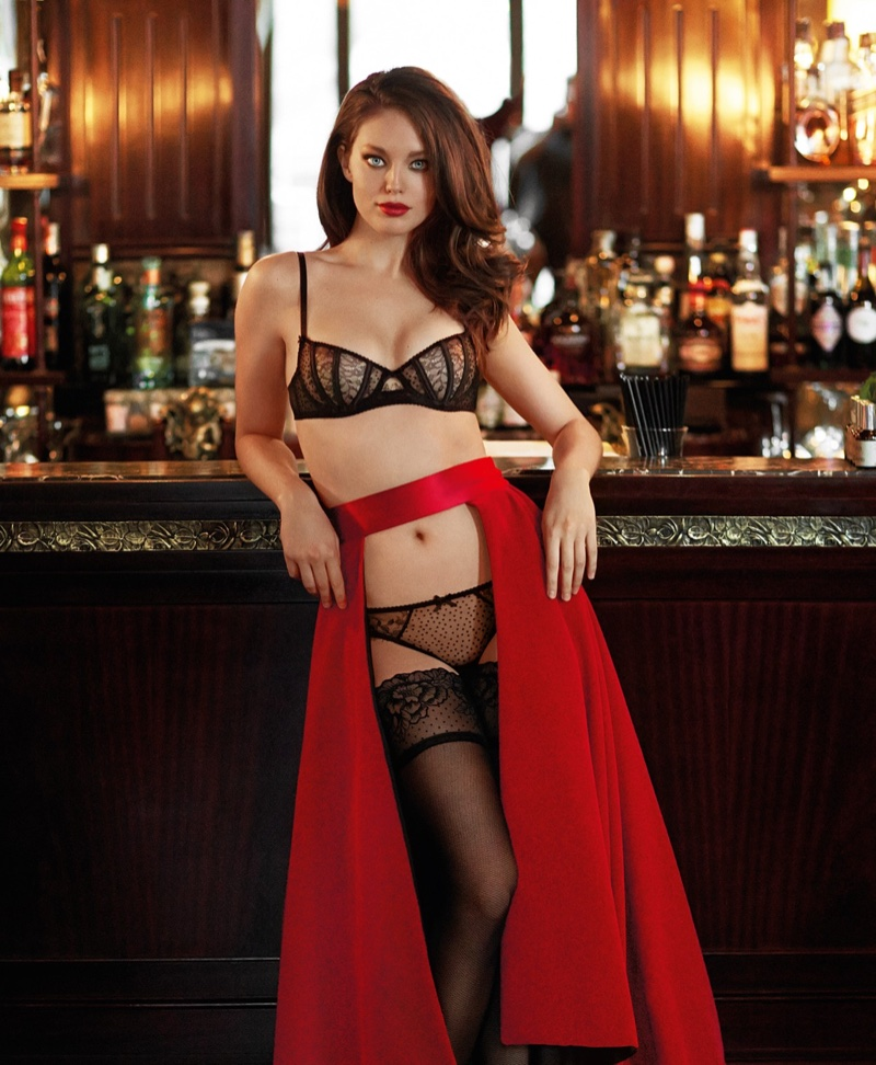 Wearing a red skirt, Emily DiDonato models Yamamay Fancy Move balconette bra and Brazilian briefs in flocked tulle