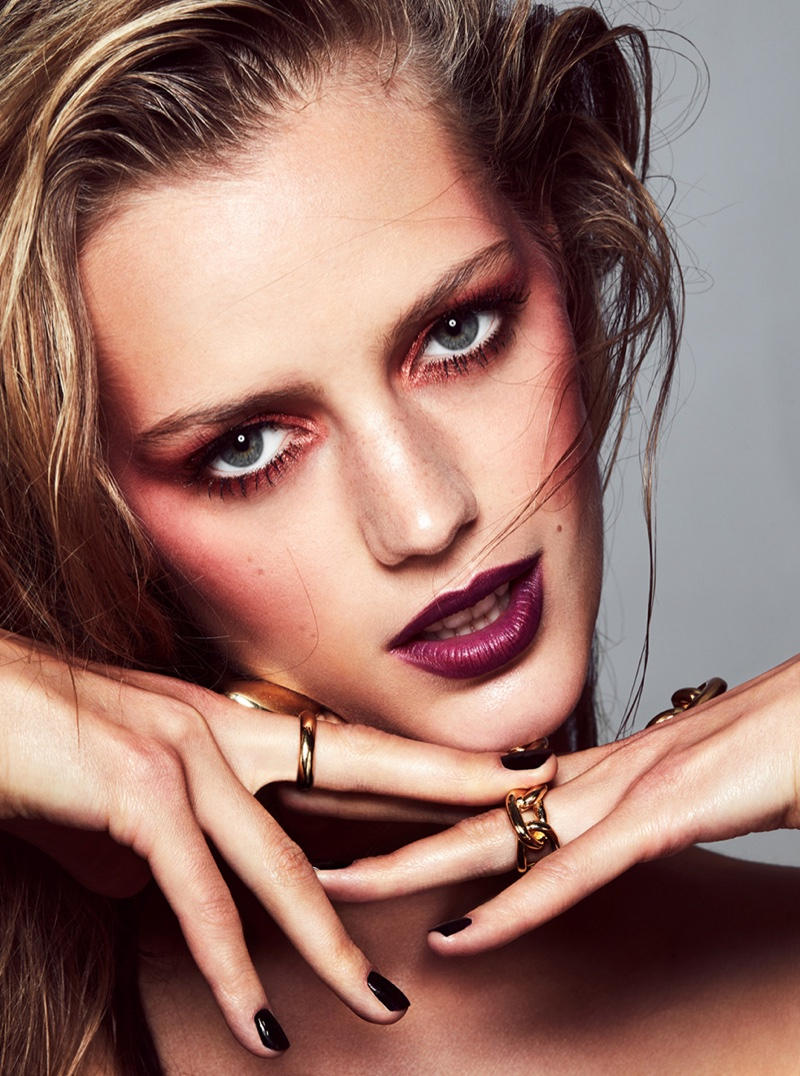 Esther Heesch shows off rouged cheeks and dark red lipstick