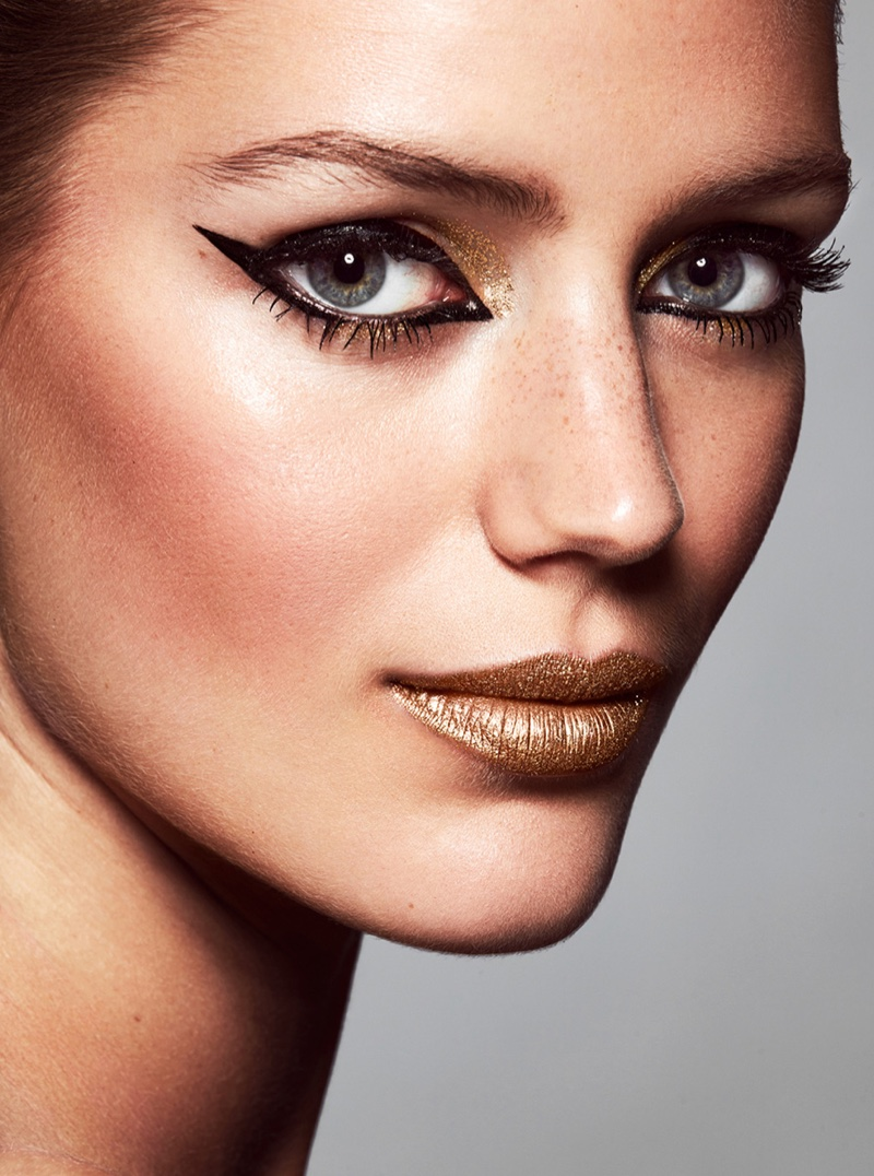 A graphic winged eyeliner and metallic lipstick stand out