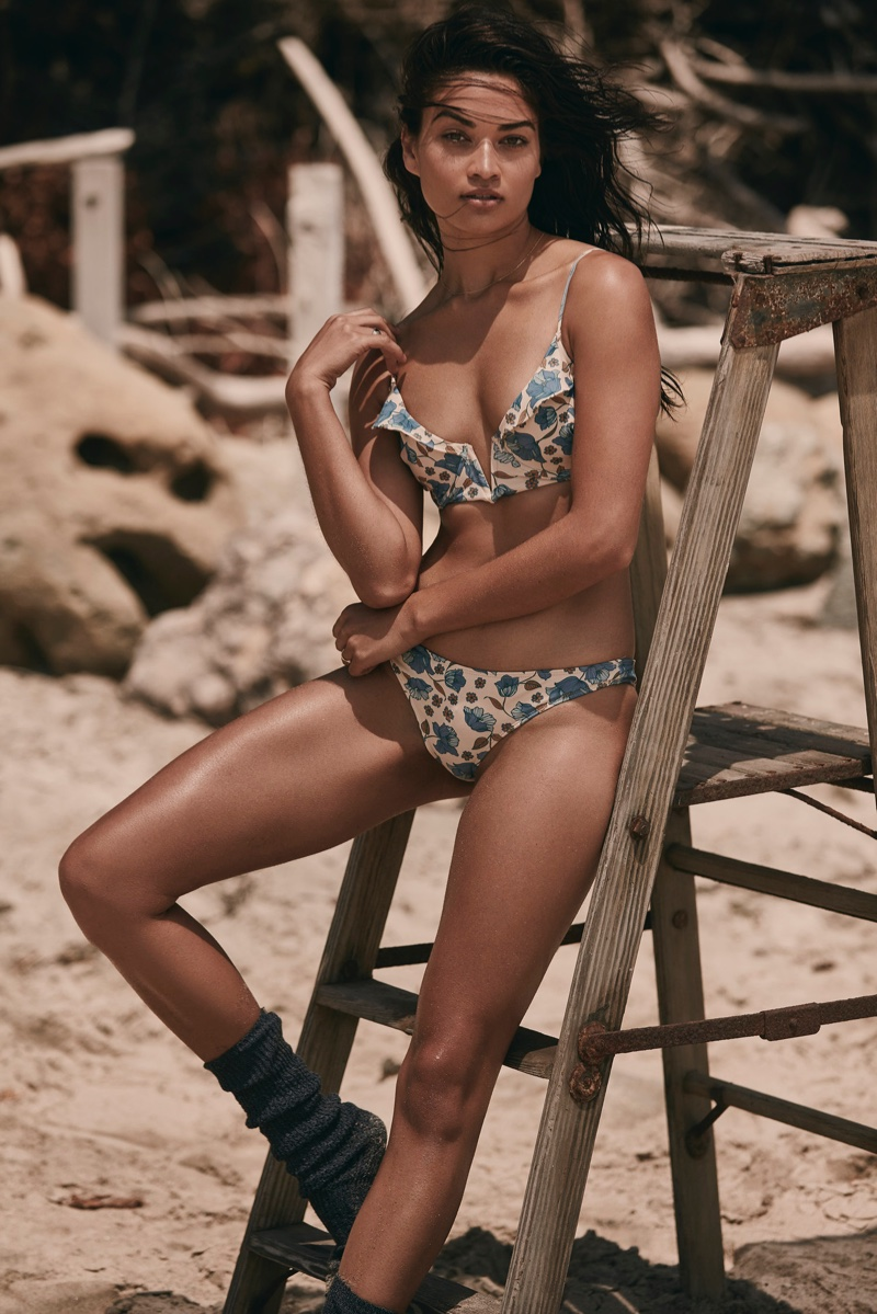Model Shanina Shaik wears For Love & Lemons Tulipe ruffle underwire top and Tulipe low rise bottoms