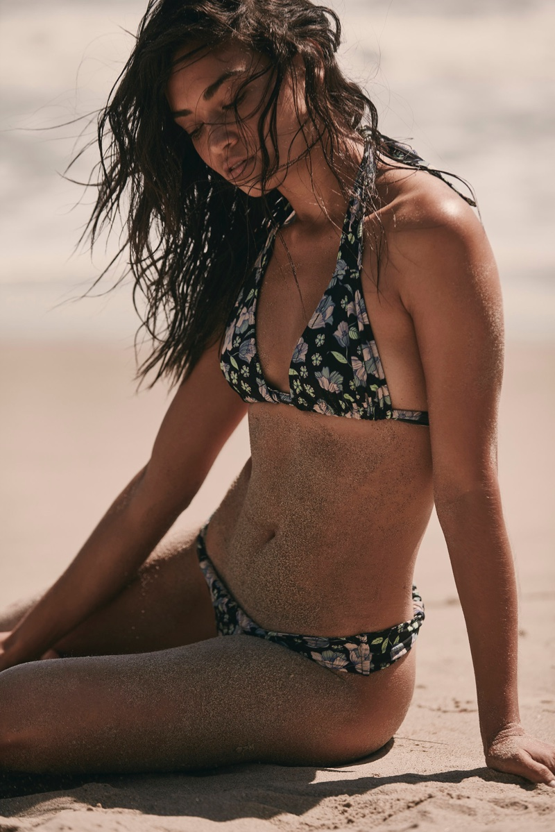 Shanina Shaik poses in For Love & Lemons Tulipe triangle top and Tulipe drawstring bottoms