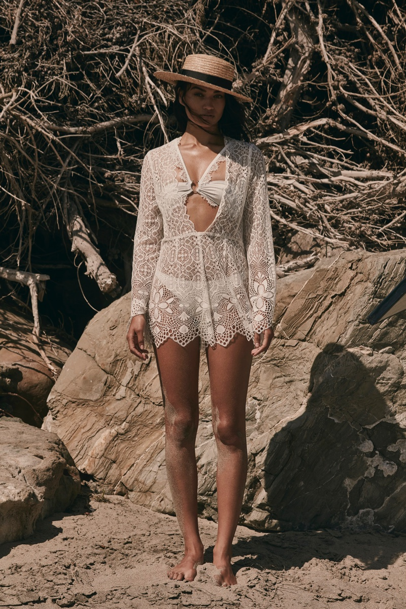 With its resort 2017 swim collection, For Love & Lemons features Caracas lace romper with La Rochelle bandeau top