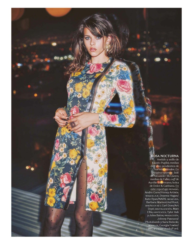 Captured at night, Georgia Fowler models Fausto Puglisi dress and ring