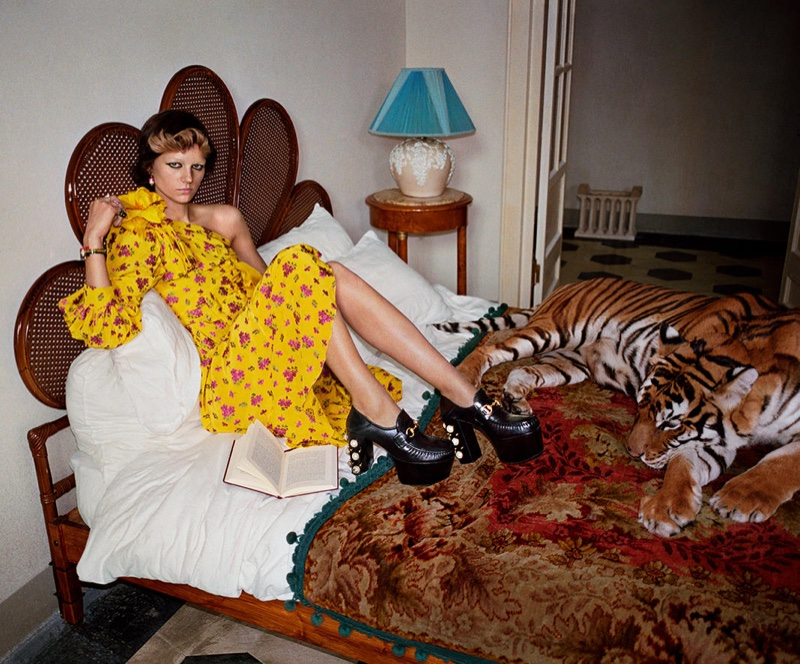 A model poses with a tiger in Gucci's spring 2017 campaign