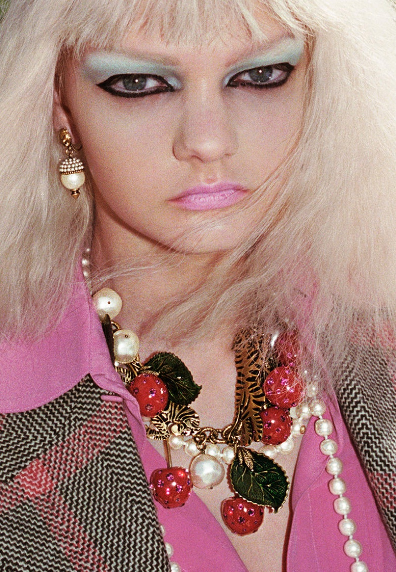 A model wears colorful jewelry and makeup in Gucci's spring 2017 campaign